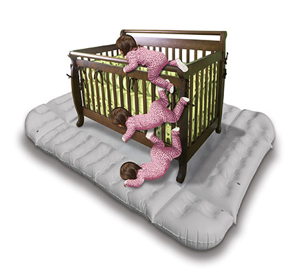 mock up of a baby climbing out of crib and landing on the dreamcatcher crib bumper inflatable